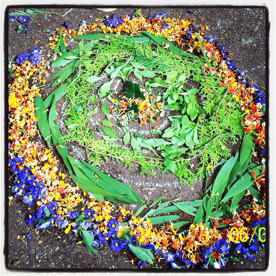 A Nature Mandala of flowers and greenery
