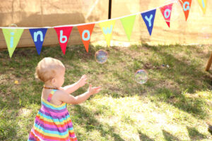 Toddler Chasing a bubble - Rainbow Yogis