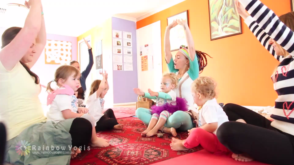 Rainbow Pammy running a toddler yoga session